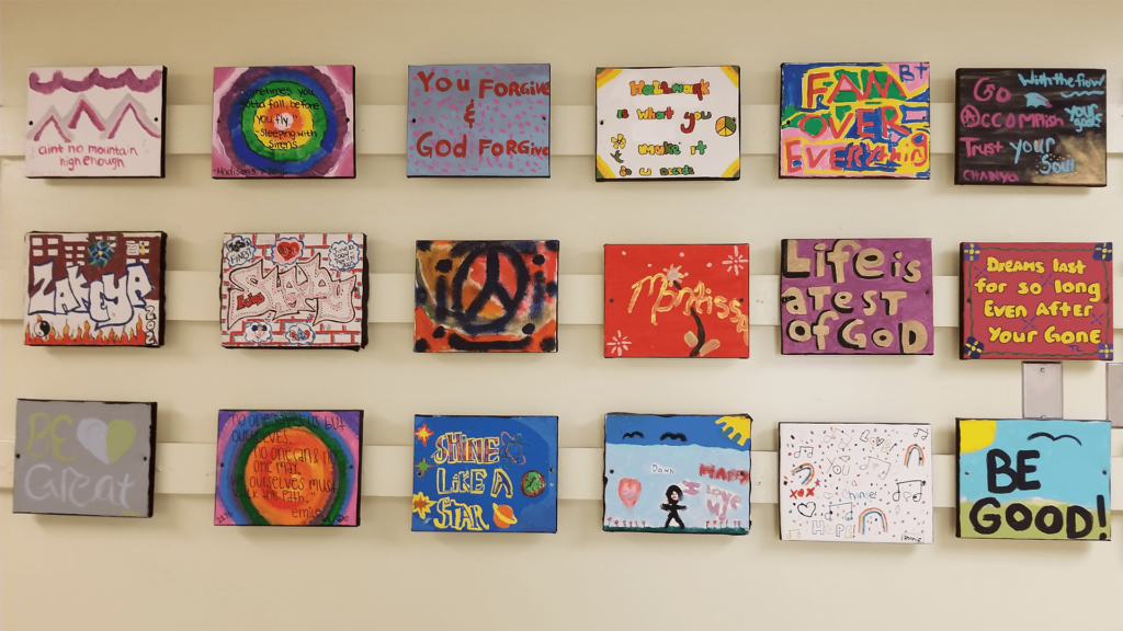 102606-Residents during Activity Therapy making wall plaques with their special twist
